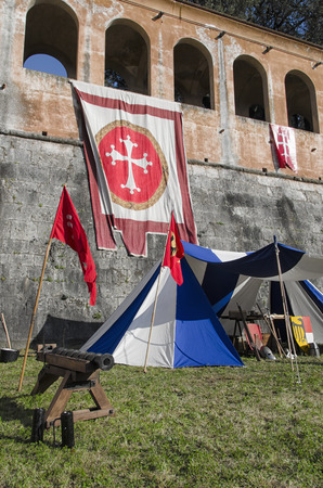 Tents and cannon in historical re-enactment in Pisa