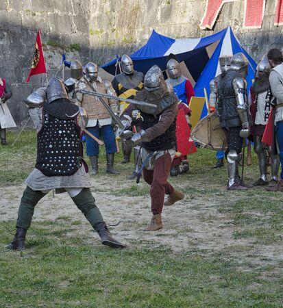 sword fight: Sword fight between knights in historical re-enactment