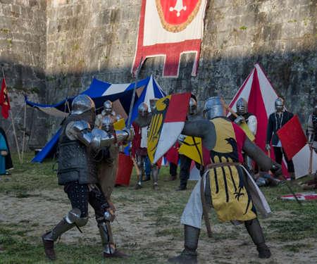 reenactment: Sword fight between knights in historical re-enactment at Pisa