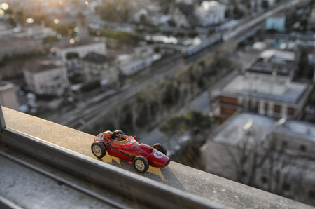 festival scales: Scale model of famous race car of the 50s at the sunset