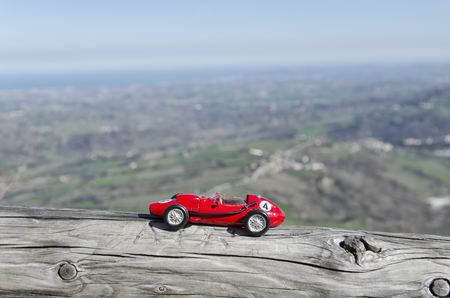 festival scales: Model of old classic car and breathtaking landscape Stock Photo