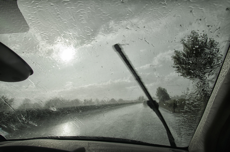 windscreen wiper: Windshield wiper in action with heavy rain