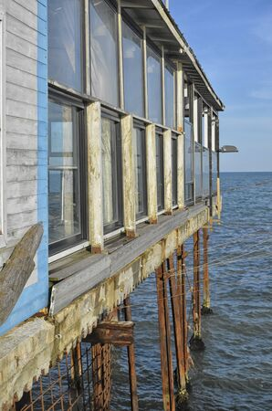 decrepit: View of structure on stilts on the Mediterranean Sea