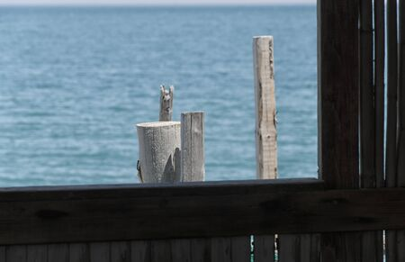 pile dwelling: Window on the sea of a fishermans house Stock Photo