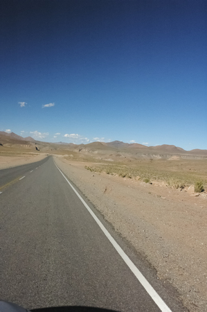 windscreen wiper: View of endless highway in the Chilean desert