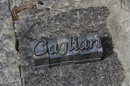 Cast metal type pieces forming the word Cagliari