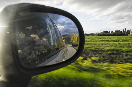 The Italian landscape from the mirror of a car Stock Photo
