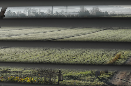 Italian countryside seen through the venetian blinds Imagens