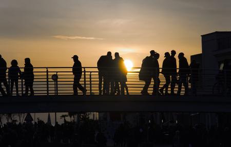 evocative: View of outline silhouettes over pedestrian bridge