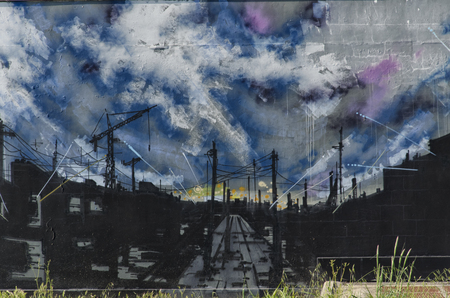 View of a mural with a dreary industrial landscape Stock Photo