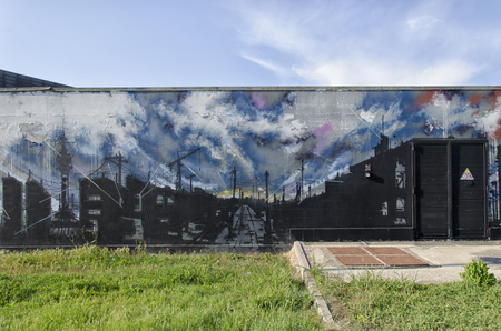 incubus: View of a mural with a post-industrial city
