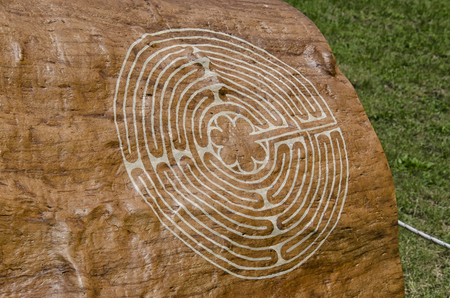 enigma: View of mysterious symbol engraved on a tree Stock Photo