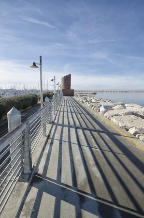 View of the walkway of the marina of Rimini