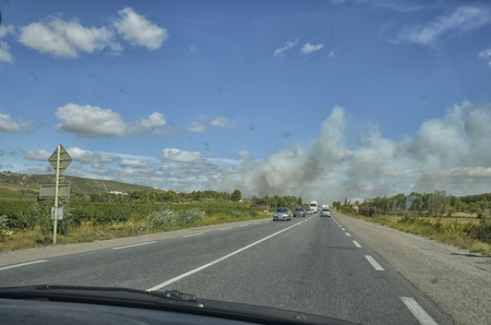 View of smoke of an arson from inside the car Stock Photo
