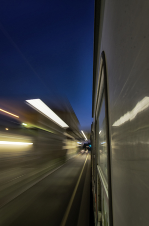 View of station lights from a train at full speed