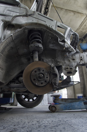 View of brakes and shock absorbers of a car