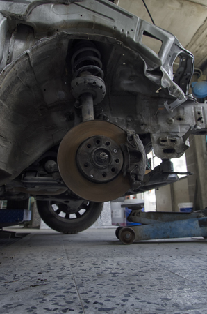 View of the brakes and shock absorbers of a car