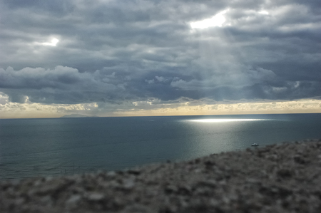 View of ray of sunshine filtering from the clouds Stock Photo
