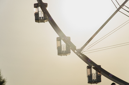 View of the gondolas of a panoramic wheel