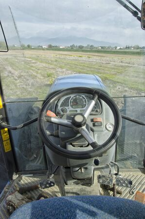 Driving a tractor that must plow the land