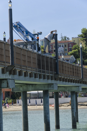Francavilla al Mare, Italy - September 12, 2017: Dangerous way to change a bulb