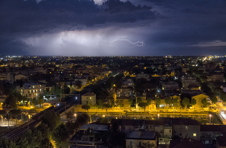 Cloud to Ground lightning bolt over the city