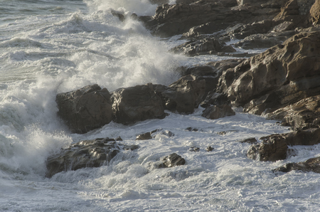 View of the rough sea on the Italian coast Stock Photo