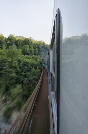 View of a train through a bridge Stock Photo