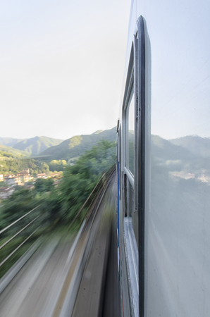 View of a train at full speed over the Apennines
