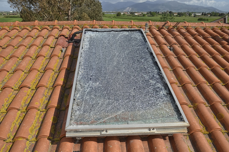 View of a solar panel damaged after a hailstorm