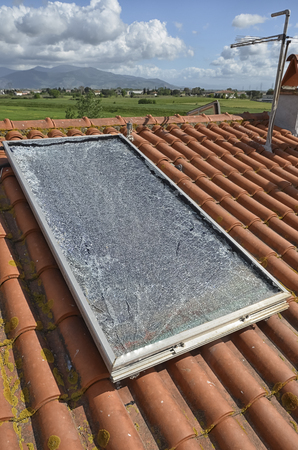 View of a shattered solar panel after a hailstorm