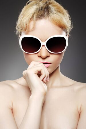 Fashion woman with sunglasses photo