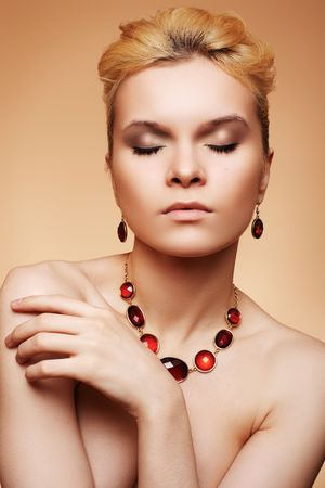Luxury woman with natural make-up and chic jewelry photo