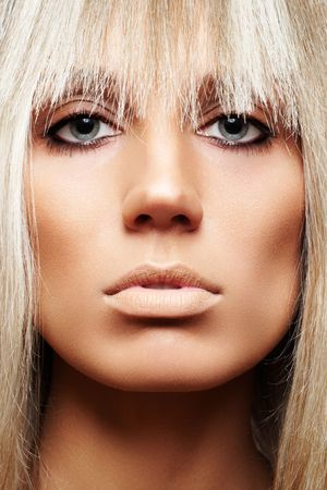luxe: Front view close-up of beauty with fringe and brown make-up Stock Photo