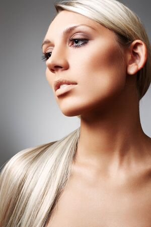 Blonde with beautiful long hair and with natural beige make-up photo