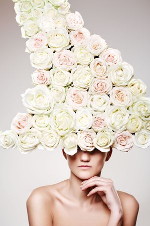 Beautiful woman with a rose headwear in a model pose