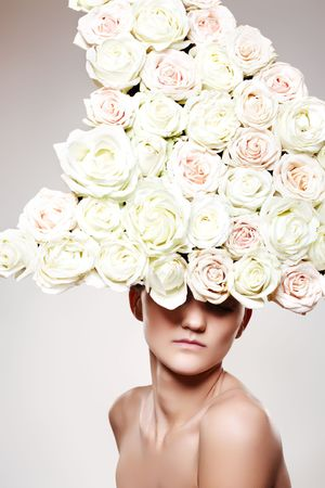 chic woman: Chic woman with a white rose headwear in a model pose