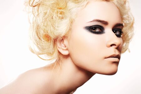 Luxury woman with curly blond hair and dark evening make-up photo