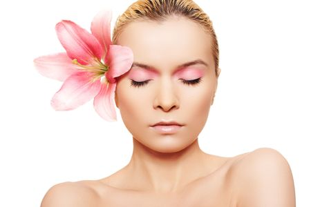 Summer spa woman with beauty pink make-up & flower Stock Photo