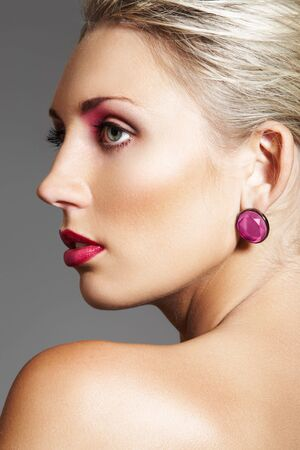 Beauty with evening make-up, bright lips & jewelry photo