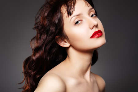 Luxury woman with evening make-up and curly long hair photo