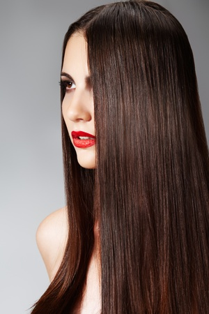 Fashion model with straight long hair and red lips photo