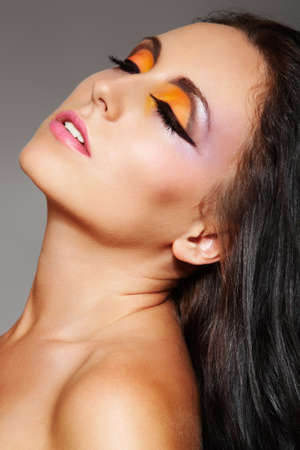 Sensual woman model with expressive oriental make-up photo