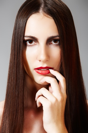 Luxury model with juicy red lips & smooth long hair Stock Photo - 8658417