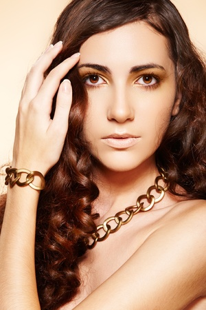 Luxury fashion woman with glamour gold accessories photo