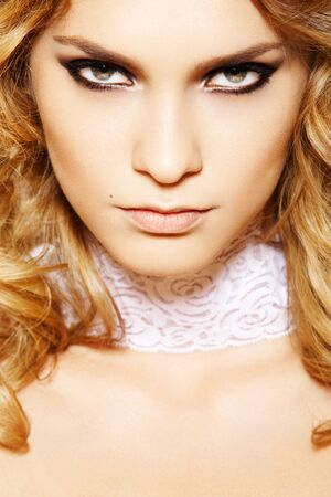Beautiful woman model with sexy evening make-up, curly long hair