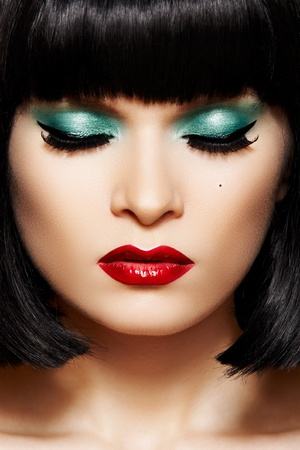 green lipstick: Bob hairstyle, christmas make-up. Close-up pure female face