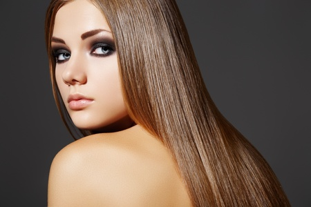 Fashion hairstyle. Model with long hair and evening make-up Stock Photo - 9305267
