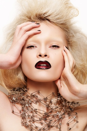 Fashion looking. Beautiful model with dark lips and without eyebrows photo