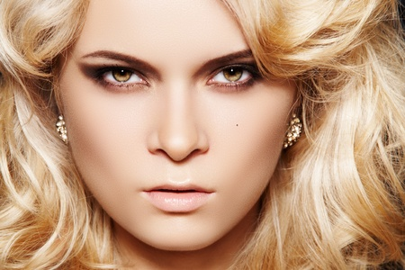 Glamour woman model with luxury make-up & chic shiny jewellery photo